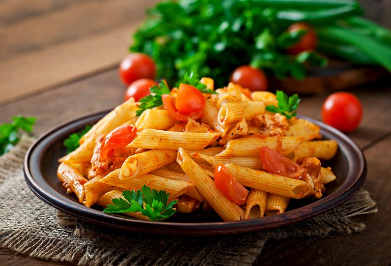 penne-pasta-tomato-sauce-with-chicken-tomatoes-wooden-table.jpg